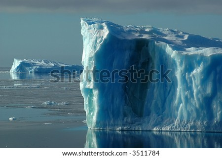 Two blue icebergs - stock photo