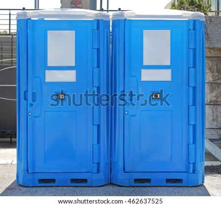 Two Blue Plastic Mobile Toilet Cabins