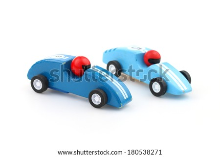 Two blue toy race cars isolated on white - stock photo