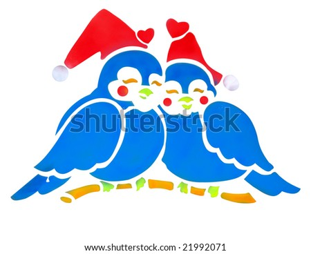 Two Bluebirds wearing Santa Hats isolated with clipping path - stock photo