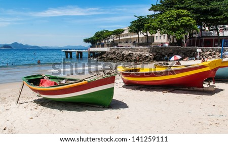 Two boats on the Copacabana beach and Fort of Copacabana in Rio de Janeiro - stock photo