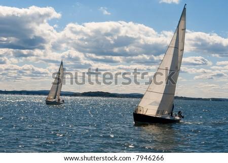 Two boats sail upwind - stock photo