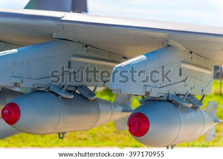 two bombs on military aviation bomber closeup - stock photo