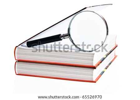 Two books and magnifier, it is isolated on white - stock photo