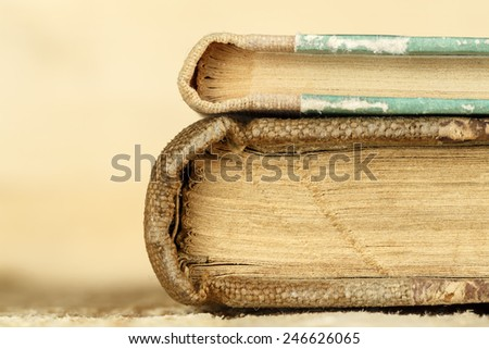 Two books are closed and one lies on the top of the other - stock photo