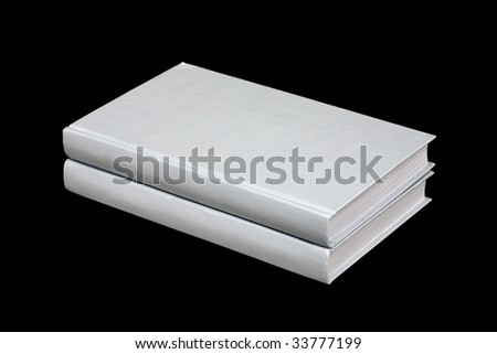 Two books lying a pile on a black background - stock photo