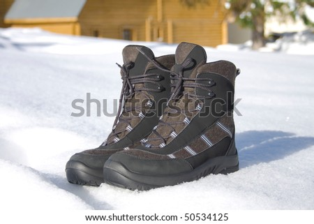Two boots for active rest stand on to snow - stock photo