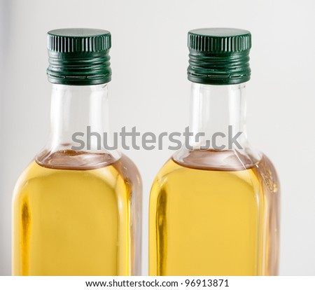 Two bottle of walnut oil on the white background