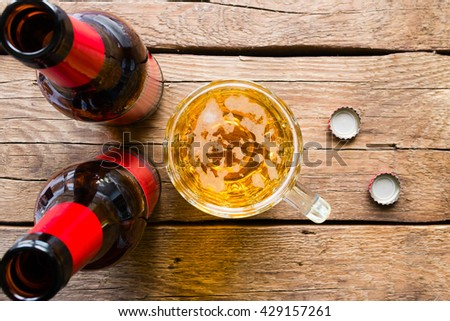two bottles and a large mug of beer - stock photo