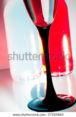 Two bottles and glass composition