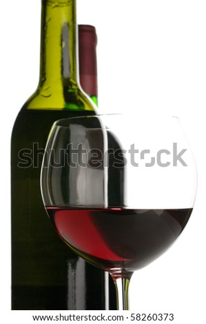 Two bottles and glass of red wine close-up on white background. - stock photo
