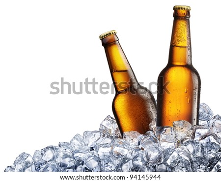 Two bottles of beer on ice cubes. Isolated on white background.