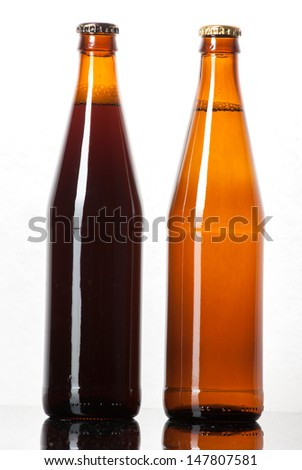 Two bottles of beer on white background