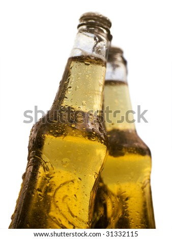 two bottles of beer with water drops - stock photo
