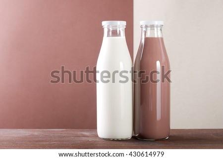 two bottles of milk chocolate - stock photo
