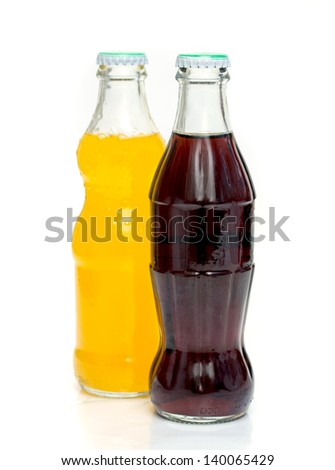 two bottles of soda isolated on a white background