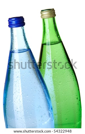 Two bottles of soda water with water drops. Closeup, isolated on white background - stock photo
