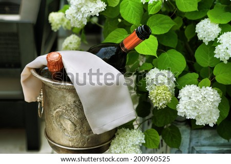 two bottles of wine being cooled in silver bucket in one of the most prestigious restaurant - stock photo