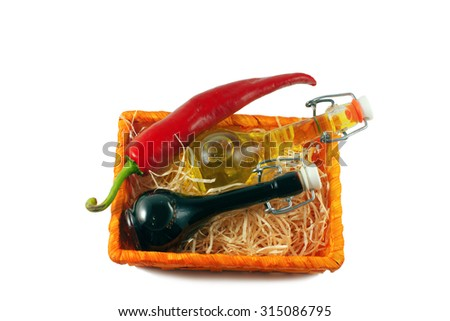 Two bottles of wine vinegar, olive oiland two red hot chilly pepper isolated on white background - stock photo