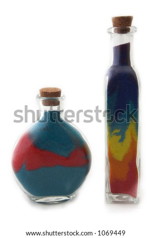 Two bottles with colorful sand - stock photo