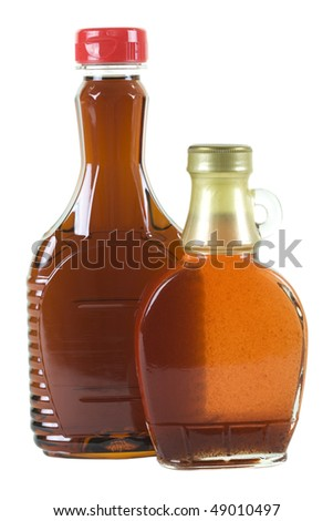 Two bottles with strawberry and maple syrup; isolated, two clipping paths included - stock photo
