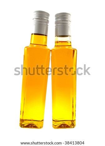 Two bottles with yellow linen oil isolated on a white background - stock photo