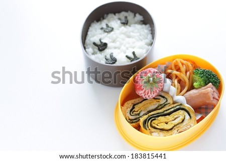 Two bowls filled with a variety of different foods. - stock photo