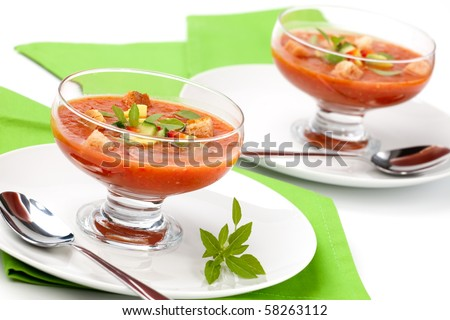 Two bowls of delicious cold Gazpacho soup with cucumber - avocado salsa. Good summer time appetizer. - stock photo