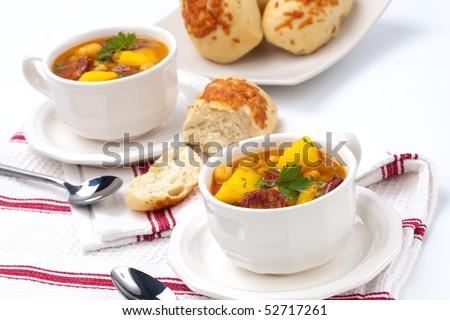 Two bowls of hot fresh golden chorizo and chickpea soup and cheese ...