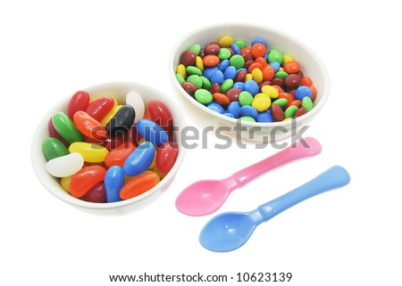 Two Bowls of Lollies and Plastic Spoons on White Background