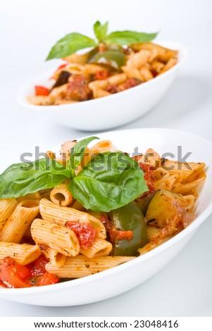 two bowls of mediterranean pasta - stock photo