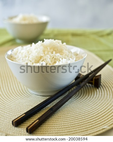 two bowls of plain rice and chopsticks - stock photo