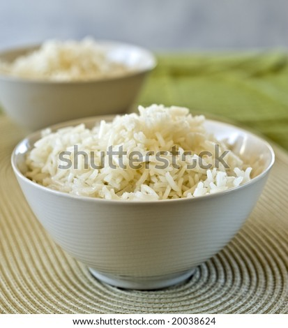 two bowls of plain rice in shallow depth of field - stock photo