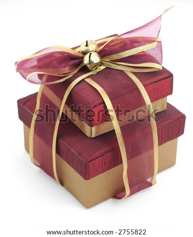 Two boxed presents, elaborately wrapped in purple and gold ribbon - stock photo
