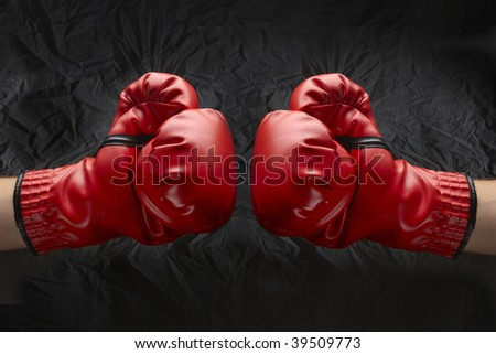 Two boxers touch gloves ready to start fight