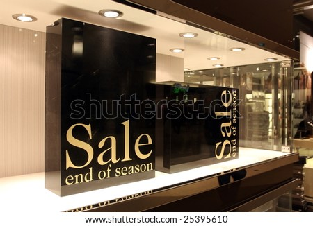two boxes for sale AD in a store window - stock photo