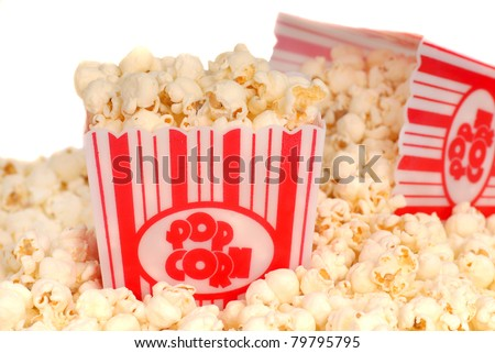 Two boxes of delicious movie popcorn with popcorn spilling out - stock photo
