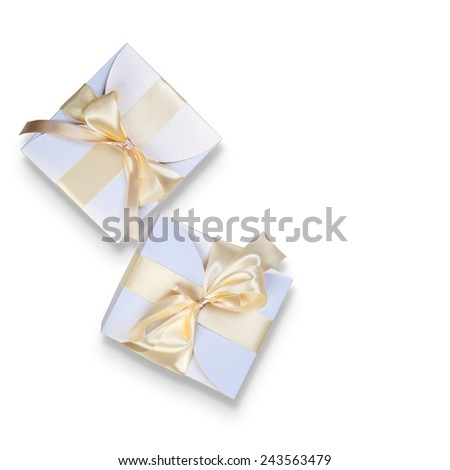 Two boxes with gold ribbon on white