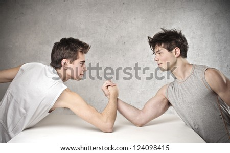 Two boy arm-wrestling - stock photo