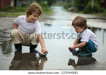 two boy play in water - stock photo