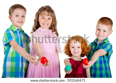 Two boys and two girls hold Easter eggs in straight arms. Children are showing Easter eggs. White background. - stock photo