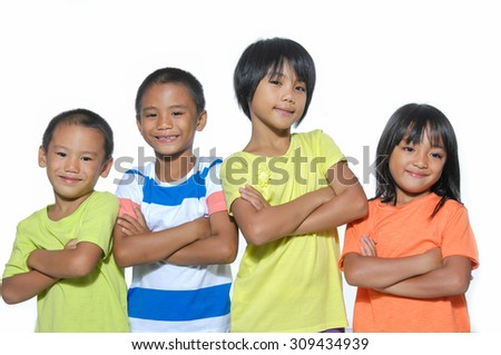 Two boys and two girls posing on white background
