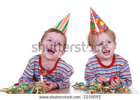 two boys celebrate birthday isolated on white