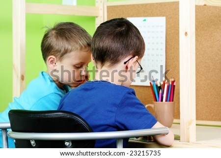 two boys doing their homework - education