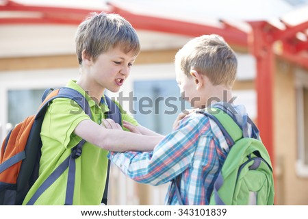 Two Boys Fighting In School Playground - stock photo