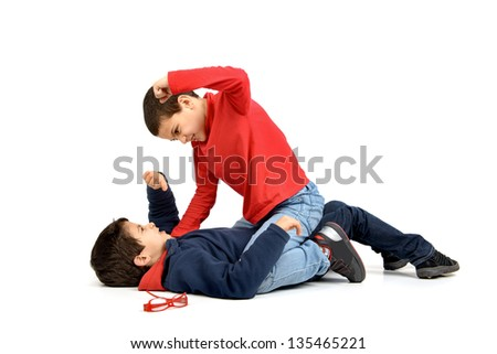 Two boys fighting isolated in white - stock photo
