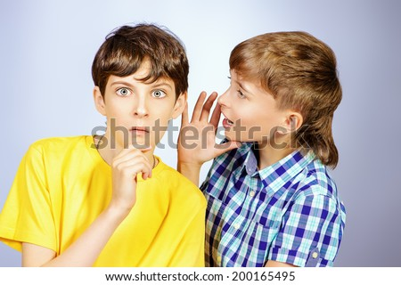Two boys friends talking with each other. Studio shot.  - stock photo