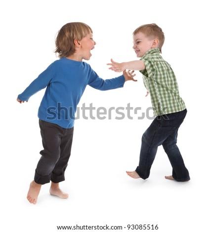 two boys having fun on white background - stock photo