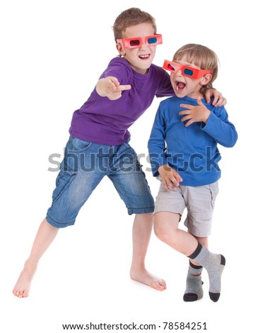 two boys having fun wearing 3D glasses - stock photo