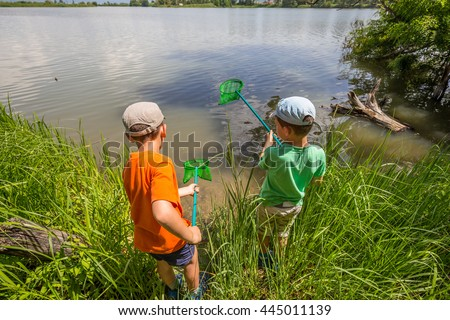 Two boys having fun with fishing nets